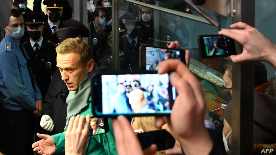 Russian opposition leader Alexei Navalny is seen at the passport control point at Moscow's Sheremetyevo airport, Jan. 17, 2021.