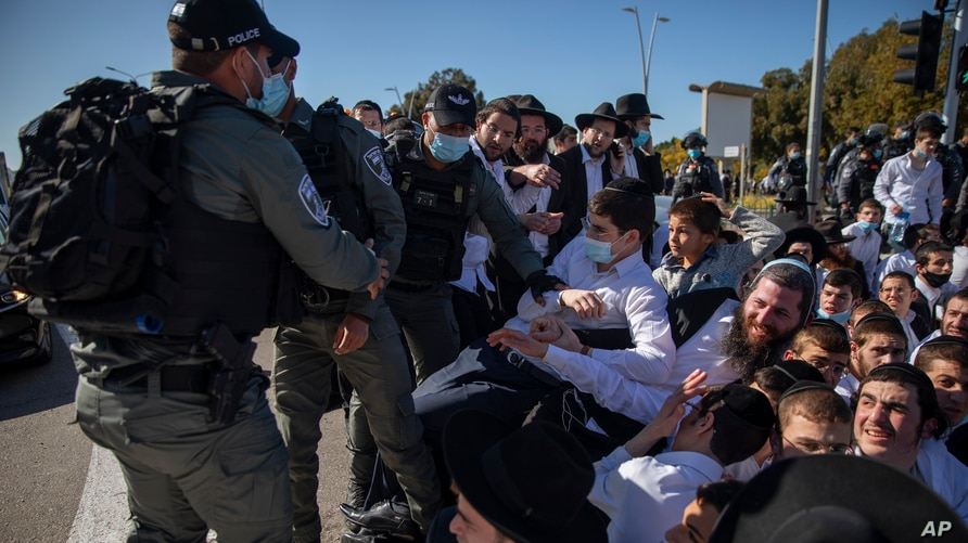 Israeli police officers clash with ultra-Orthodox Jews in Ashdod, Israel, Jan. 24, 2021.