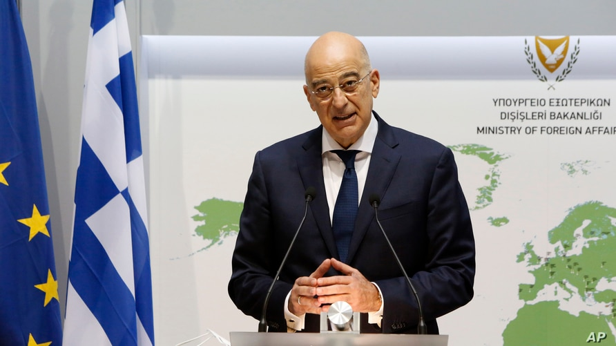 Greek Foreign Minister Nikos Dendias talks to the media during a press conference after a meeting with his Cyprus counterpart Nicos Christodoulides at the Foreign Ministry house in divided capital Nicosia, Cyprus, Dec. 4, 2020.