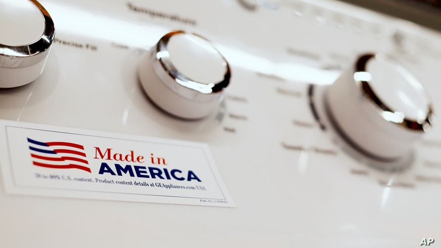 FILE - A General Electric washing machine with a label advertising it was made in America is displayed in a retail store in Cranberry Township, Pennsylvania, May 9, 2019.