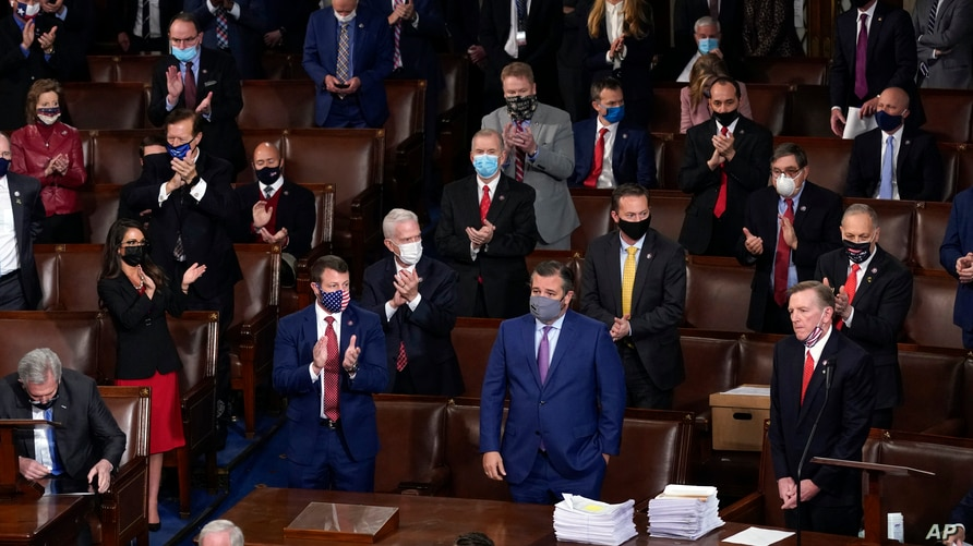 FILE - Republican lawmakers applaud after Arizona Congressman Paul Gosar, lower right, objected to certifying the Electoral College votes from his state, during a joint session of Congress, at the Capitol, in Washington, Jan 6, 2021.