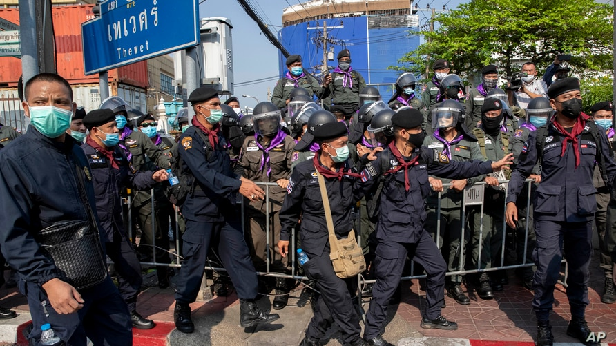 Police move to strengthen barriers with pro-democracy protesters during a rally, Dec. 10, 2020 in Bangkok, Thailand.