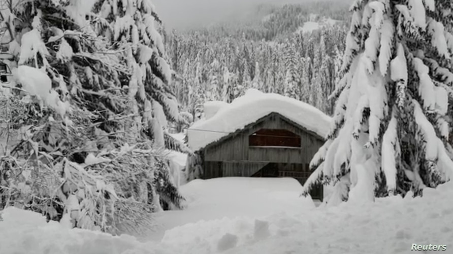 General view after heavy snowfall in Sappada, Italy, Jan. 3, 2021, in this still image obtained from a social media video.
