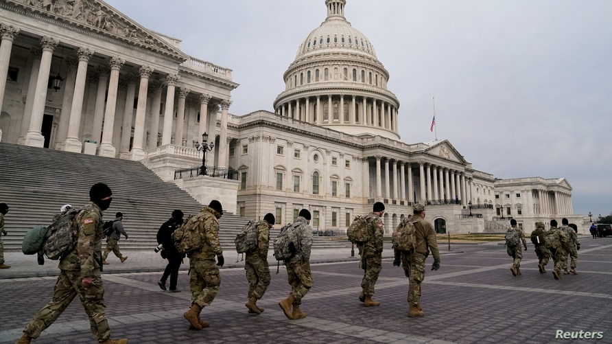Members of the National Guard arrive to the U.S. Capitol days after supporters of U.S. President Donald Trump stormed the Capitol in Washington, D.C.