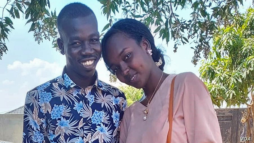 FILE - Sudanese national Ishan Ahmed Abdallah, right, and South Sudanese national Deng Anei Awen are seen in an undated photo. Now, the married couple live in fear. (Viola Elias/VOA)