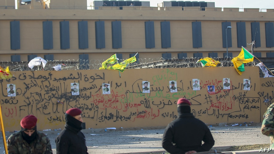 The portraits of fighters from Kataeb Hezbollah (Hezbollah Brigades) seen on the wall of the US embassy in the Iraqi capital…