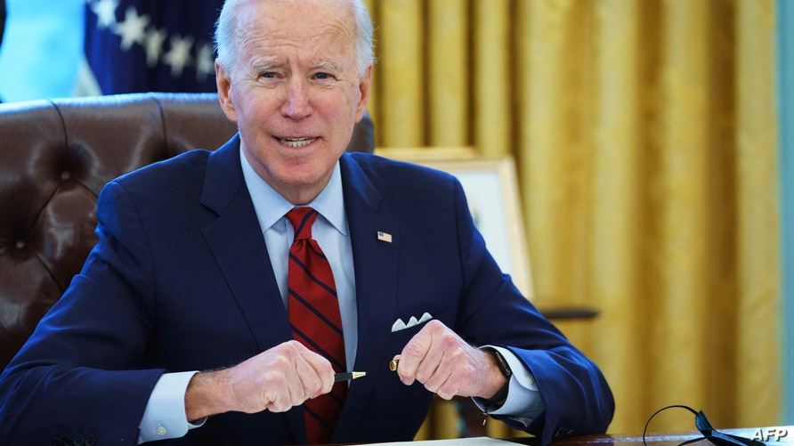 US President Joe Biden prepares to sign  executive orders on affordable healthcare in the Oval Office of the White House in…