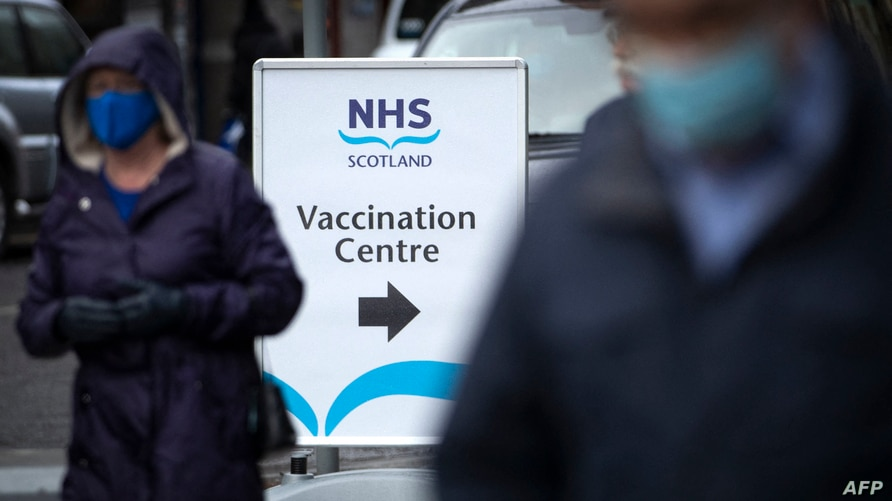 Members of the public pass an NHS Scotland vaccination centre set up at the Edinburgh International Conference Centre (EICC) in…