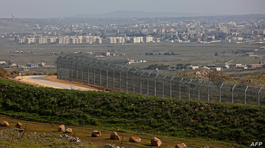 This picture taken from the Israeli-annexed Golan Heights on February 4, 2021, shows the border fence with the Syrian…