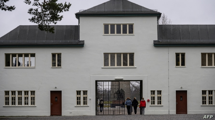(FILES) This file photo taken on February 07, 2020 shows the main gate in the former Sachsenhausen concentration camp, now a…