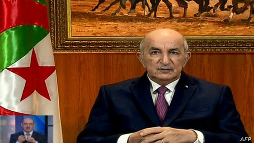 A video grab from Algeria 3 public channel shows Algerian President Abdelmadjid Tebboune giving a televised speech in which he…