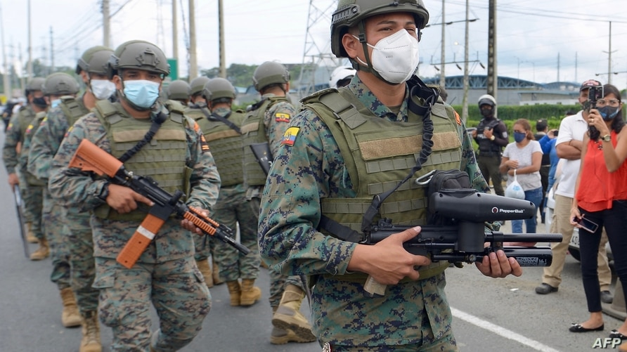 Members of the Ecuadorian Marine Force patrol outside the Zone 8 Deprivation of Liberty Center in Guayaquil, Ecuador, on…