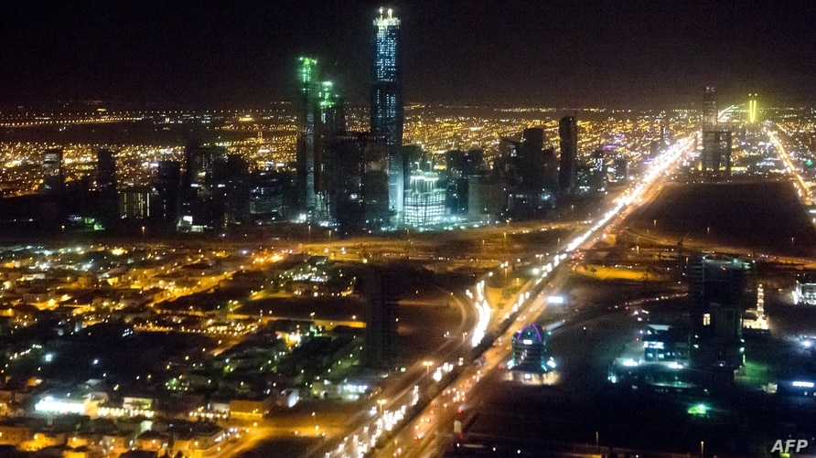 The skyline of Riyadh, Saudi Arabia, March 28, 2014, is seen at night in this aerial photograph from a helicopter. AFP PHOTO /…