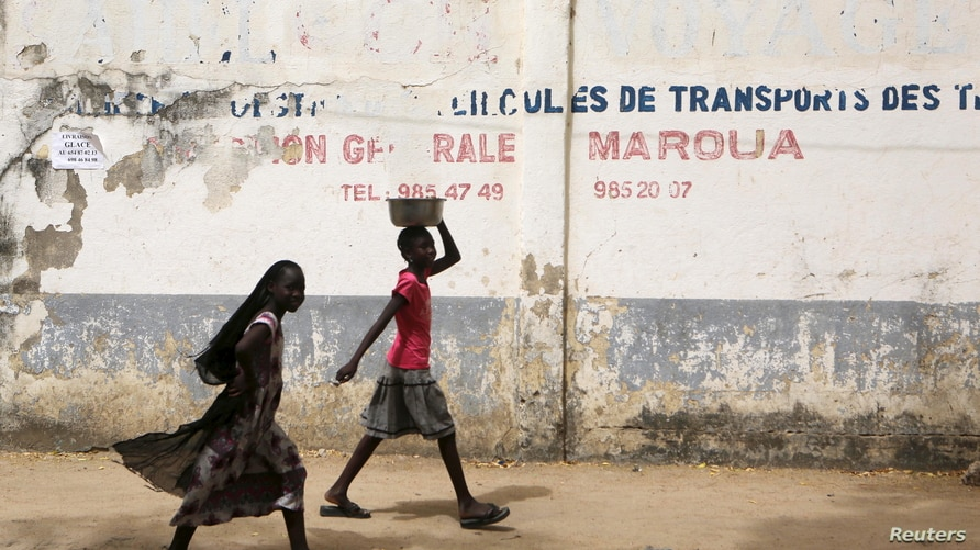 Girls walk on a road in Maroua, Cameroon, March 17, 2016. After watching its influence spread during a six-year campaign that…