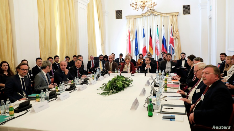 FILE - Iran's top nuclear negotiator Abbas Araqchi and Secretary General of the EEAS attend Vienna meeting