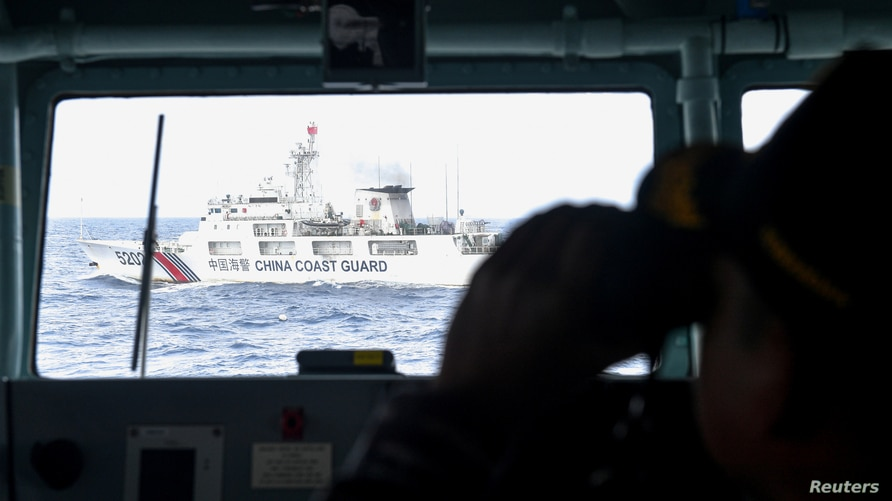 China Coast Guard ship is seen from an Indonesian Naval ship during a patrol at IndonesiaÕs Exclusive Economic Zone sea in the…