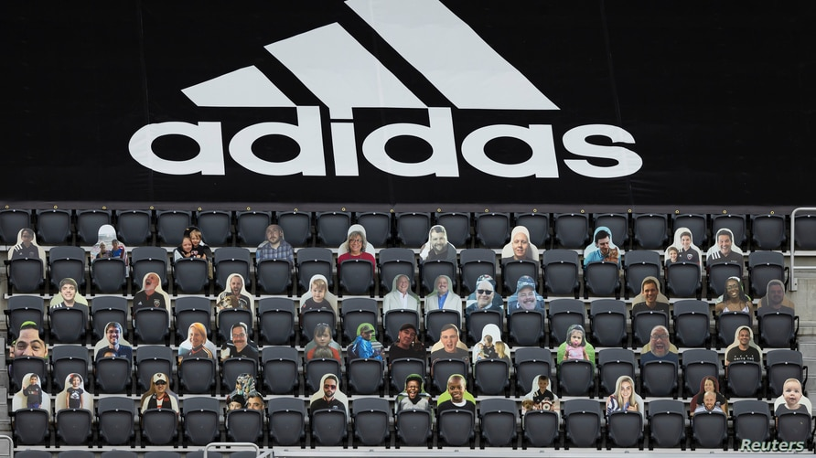Sep 27, 2020; Washington, D.C., USA; A general view of the stadium with fan cutouts in seats below an Adidas branded tarp…