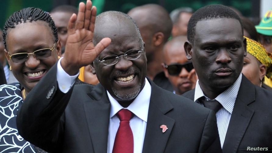 FILE - Tanzania's President elect John Magufuli salutes members of the ruling Chama Cha Mapinduzi Party (CCM) at the party's sub-head office on Lumumba road in Dar es Salaam.