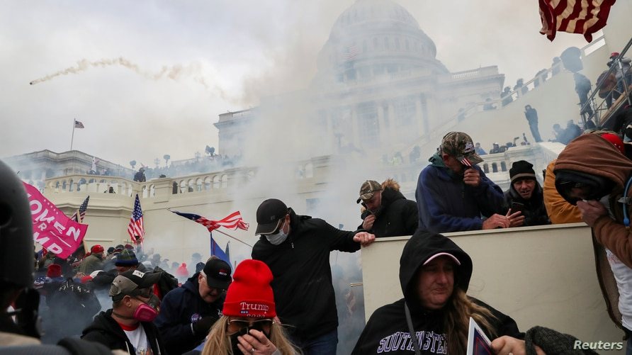 Supporters of U.S. President Donald Trump clash with police officers in front of the U.S. Capitol Building in Washington, January 6, 2021.