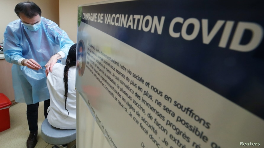 A medical staff member receives a dose of the Pfizer-BioNTech coronavirus disease (COVID-19) vaccine at the at the CHR Centre…