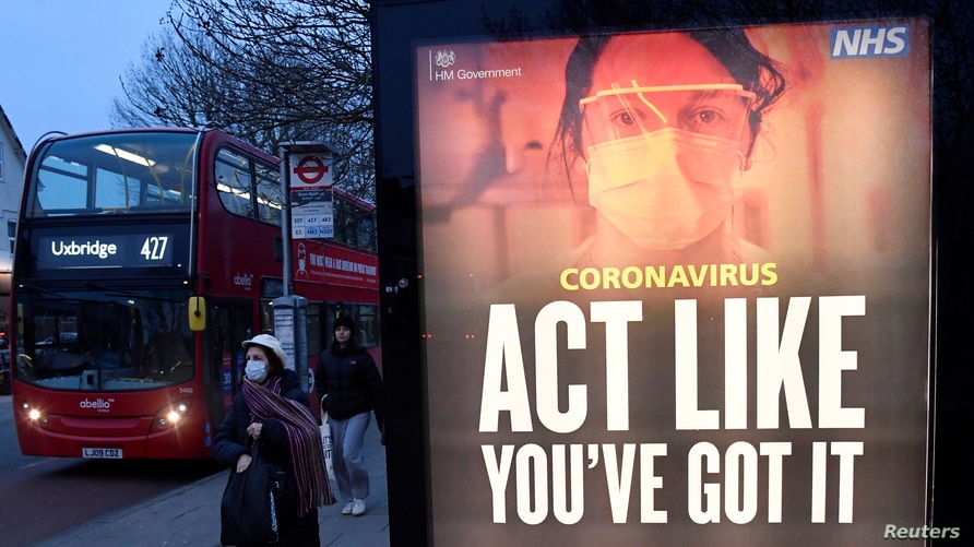 A public health information message is seen at a bus stop in West Ealing as the South African variant of the novel coronavirus…