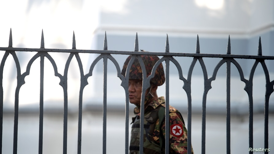 A Myanmar soldier looks on as he stands inside city hall after soldiers occupied the building, in Yangon, Myanmar February 2,…