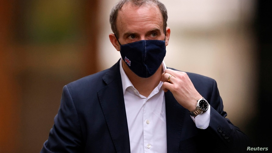 Britain's Foreign Affairs Secretary Dominic Raab walks outside Downing Street in London, Britain, February 3, 2021. REUTERS…