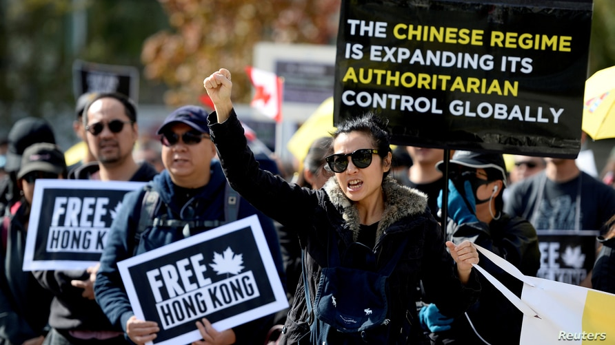 FILE PHOTO: Supporters hold a rally in solidarity with Hong Kong protesters, in Vancouver, British Columbia, Canada September…