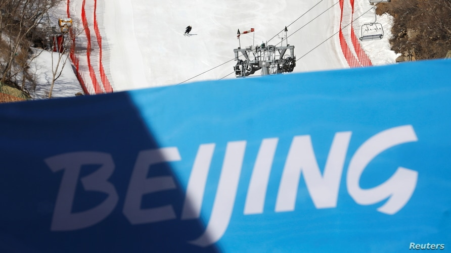 A staff member skis down a slope during an organised media tour to the National Alpine Skiing Centre, a venue of the 2022…
