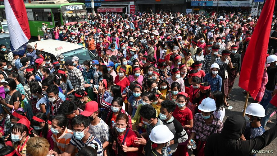 People take part in a protest against the military coup and demand the release of elected leader Aung San Suu Kyi, in Yangon, Myanmar, Feb. 6, 2021.
