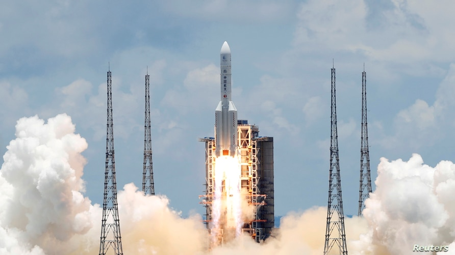 FILE PHOTO: The Long March 5 Y-4 rocket, carrying an unmanned Mars probe of the Tianwen-1 mission, takes off from Wenchang…