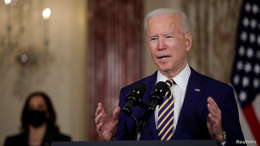 FILE PHOTO: U.S. President Joe Biden delivers a foreign policy address as Vice President Kamala Harris listens, at the State…