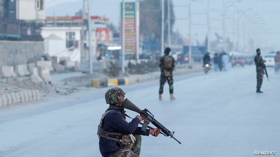 Afghan National Army soldiers keep watch near the site of a blast in Jalalabad, Afghanistan February 11, 2021. REUTERS/Parwiz