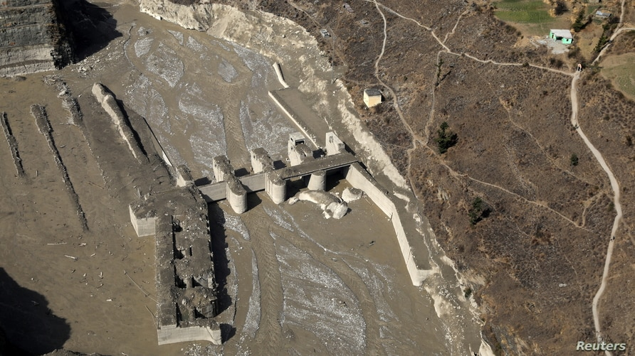 An aerial view shows a damaged barrage after a flash flood swept a mountain valley destroying dams and bridges, in Tapovan.