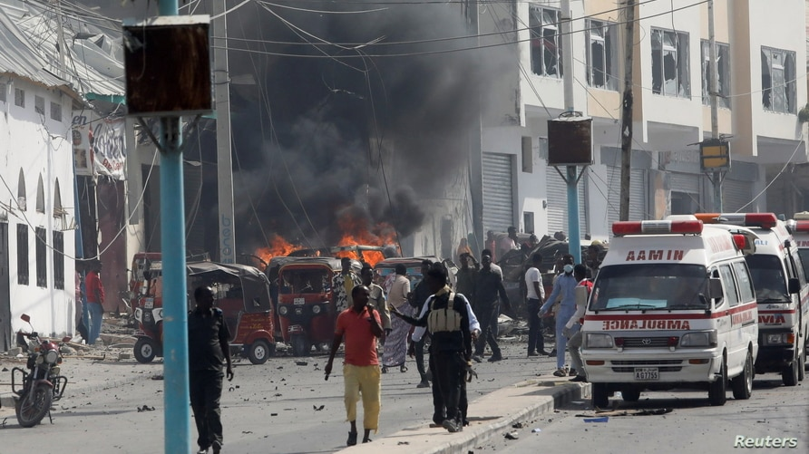 Somali security officers secure the scene of an explosion in Mogadishu, Somalia, Feb. 13, 2021.