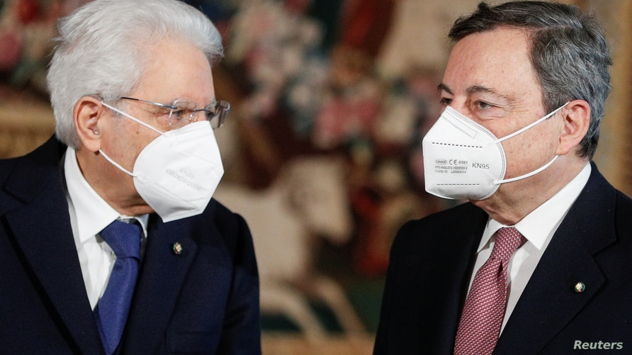 Italian President Sergio Mattarella and Prime Minister Mario Draghi wearing face masks speak after the new cabinet ministers swearing-in ceremony, at the Quirinale Presidential Palace in Rome, Italy, Feb. 13, 2021.