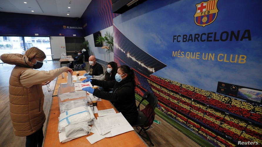 A woman casts her ballot in a polling station at FC Barcelona's Auditorium, next to Camp Nou stadium, during regional elections…