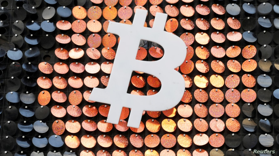 FILE - The logo of the Bitcoin digital currency is seen in a shop in Marseille, France, Feb. 7, 2021.