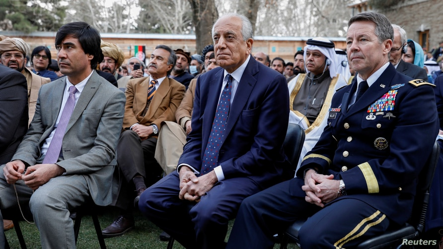 FILE PHOTO: U.S. envoy for peace in Afghanistan Zalmay Khalilzad (C) and U.S. Army General Scott Miller, commander of NATO's…
