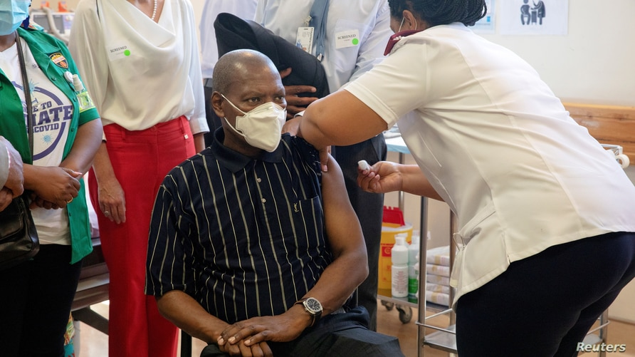 FILE PHOTO: South African Health Minister Zweli Mkhize receives the Johnson and Johnson coronavirus disease (COVID-19)…