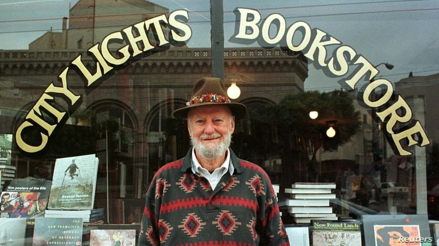 FILE PHOTO: Lawrence Ferlinghetti stands outside his bookstore in San Francisco, California, U.S. August 18, 1998. Stringer…