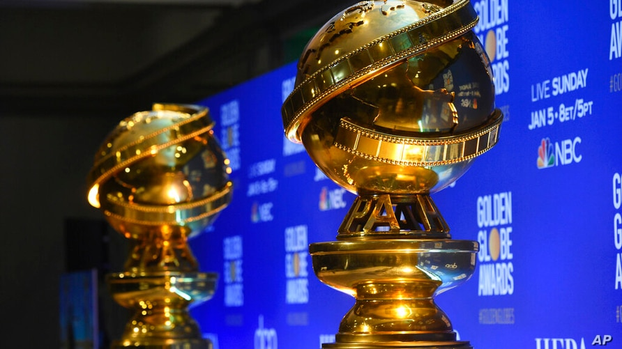 FILE - This Dec. 9, 2019 file photo shows replicas of Golden Globe statues at the nominations for the 77th annual Golden Globe…