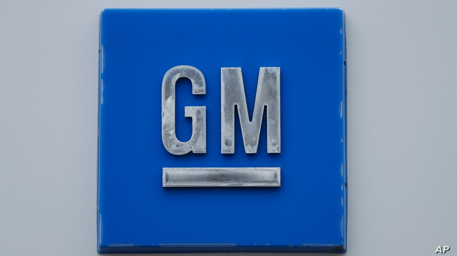 FILE - In this Jan. 27, 2020 file photo, a GM logo is shown at the General Motors Detroit-Hamtramck Assembly plant in Hamtramck…