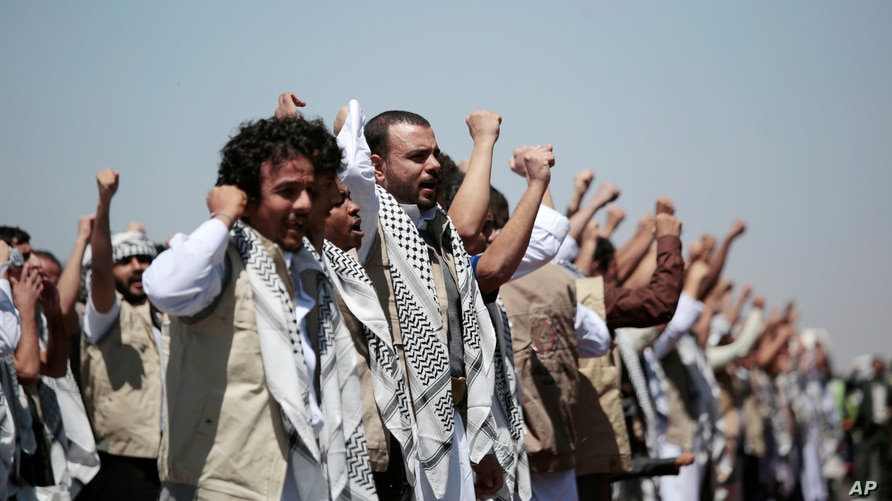 FILE - In this Oct. 16, 2020, file photo, Yemeni prisoners chant slogans during their arrival after being released by the Saudi…