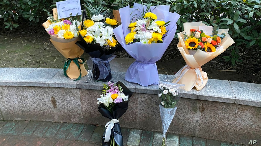 Floral tributes left outside Wuhan Central Hospital in memory of Li Wenliang, the whistleblower doctor who sounded the alarm…