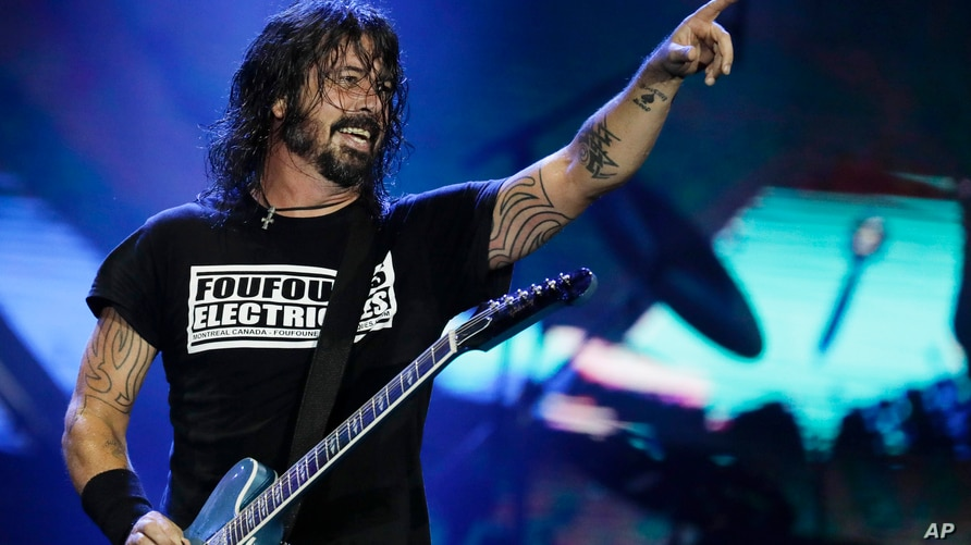 FILE - Dave Grohl of the band Foo Fighters performs at the Rock in Rio music festival in Rio de Janeiro, Brazil.