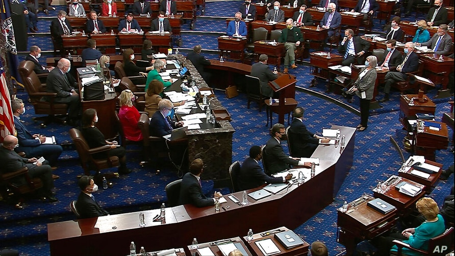 In this image from video, senators vote during the second impeachment trial of former President Donald Trump in the Senate at…