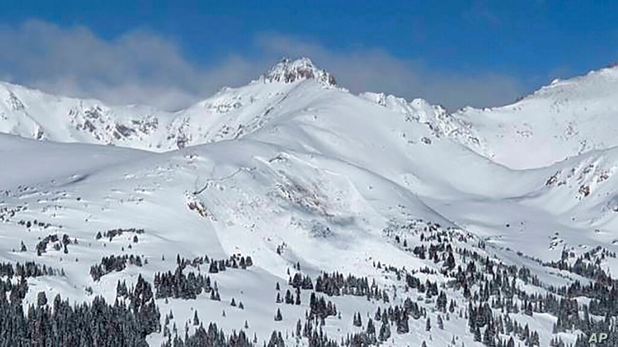 This image provided by Colorado Avalanche Information Center shows an avalanche that killed an unidentified snowboarder on…