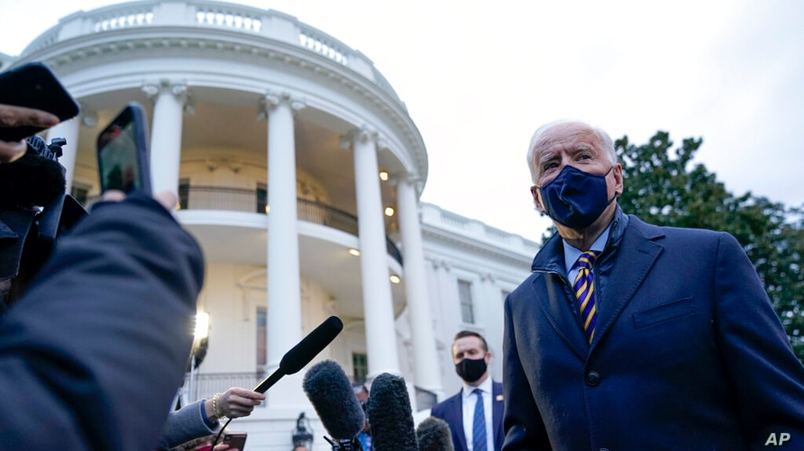 President Joe Biden talks to reporters on the South Lawn of the White House before boarding Marine One, Tuesday, Feb. 16, 2021,…