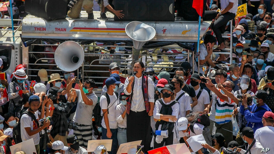 Demonstrators gather in an intersection close to Sule Pagoda to protest against the military coup in Yangon, Myanmar Wednesday,…
